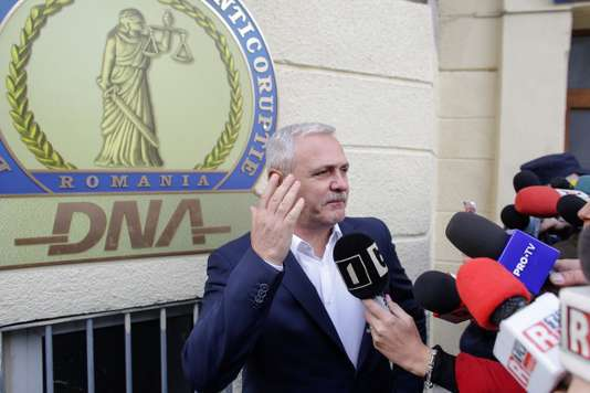 Social Democrat Party leader Liviu Dragnea gestures after leaving the Romanian anti-corruption prosecutors headquarters in Bucharest